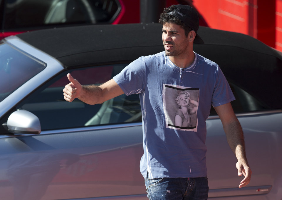 Photo - Atletico's Diego Costa arrives at the club's training ground in Madrid, Spain,Tuesday April 8, 2014. Atletico Madrid will play FC Barcelona Wednesday in a 2nd leg, quarterfinal Champions League soccer match in Madrid. (AP Photo/Paul White)