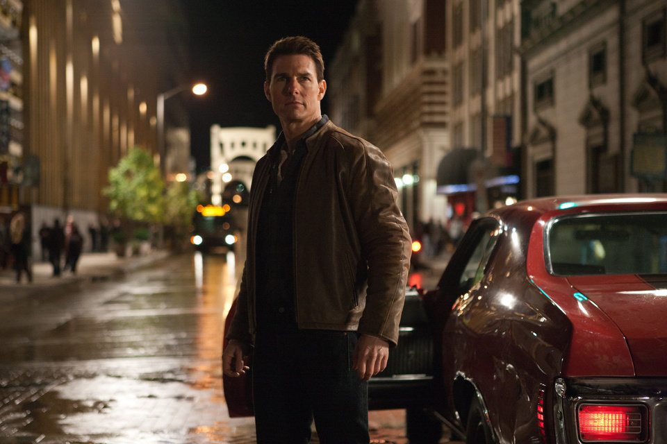 "FILE - This publicity film image released by Paramount Pictures shows Tom Cruise in a scene from ""Jack Reacher."" Cruise plays a former military cop investigating a sniper case. The Film Society of Lincoln Center in New York canceled Monday's Dec. 17, 2012 screening of Tom Cruise's violent new movie, ""Jack Reacher,"" that was to include a conversation with the actor. A scheduled premiere of the movie in Pittsburgh had also been postponed over the weekend. (AP Photo/Paramount Pictures, File)"