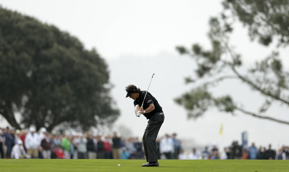 Photo - Phil Mickelson hits his second shot from the fairway of the second hole of the south course during the second round of the Farmers Insurance Open golf tournament Friday, Jan. 24, 2014, in San Diego. (AP Photo/Gregory Bull)