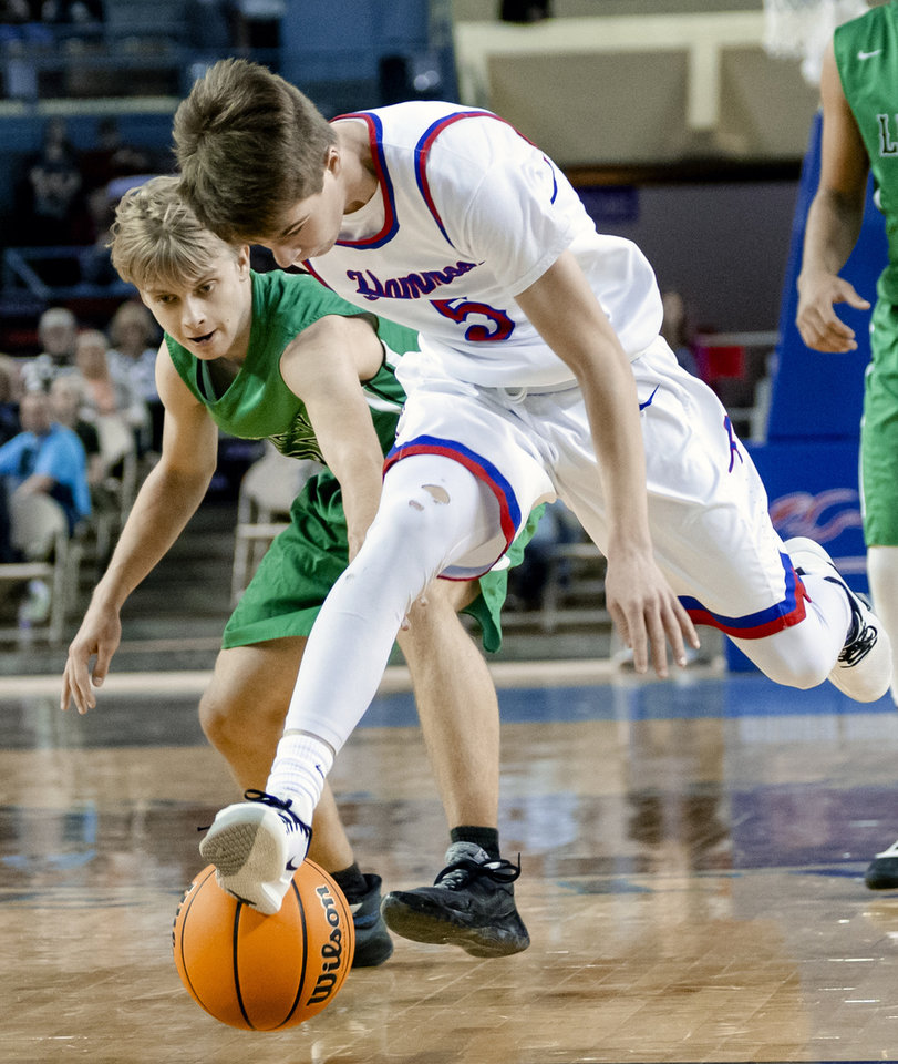 Photo - Leedey's Parker Ward (15) defends on Hammon's Jaxon Spikes (5) during a Class B boys state tournament semi-final basketball game between Hammon vs Leedey in the Jim Norick Arena at State Fair Park in Oklahoma City, Okla. on Friday, March 6, 2020.  [Chris Landsberger/The Oklahoman]