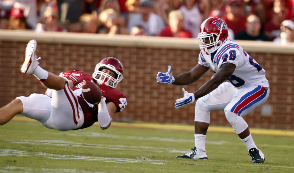 Photo - Oklahoma Sooner Caleb Gastelum (45) deflects a pass intended for Kenneth Dixon during a college football game between the University of Oklahoma Sooners (OU) and the Louisiana Tech Bulldogs at Gaylord Family-Oklahoma Memorial Stadium in Norman, Okla., on Saturday, Aug. 30, 2014. Photo by Steve Sisney, The Oklahoman