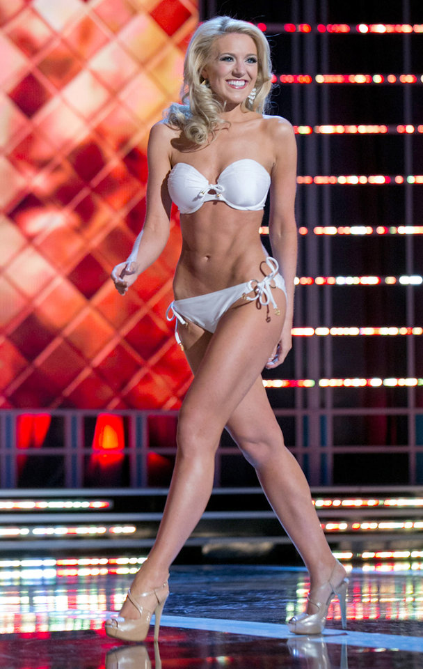 Photo - This photo courtesy Miss America Organization shows Miss Washington Mandy Schendel who took the trophy for the third round of the Lifestyle and Fitness category after modeling a strapless white Catalina swimsuit on Thursday. Jan. 10, 2013, at the Planet Hollywood casino in Las Vegas. The 22-year-old from Newcastle, Wash., earned a $1,000 Amway scholarship for it.  (AP Photo/Miss America Organization)