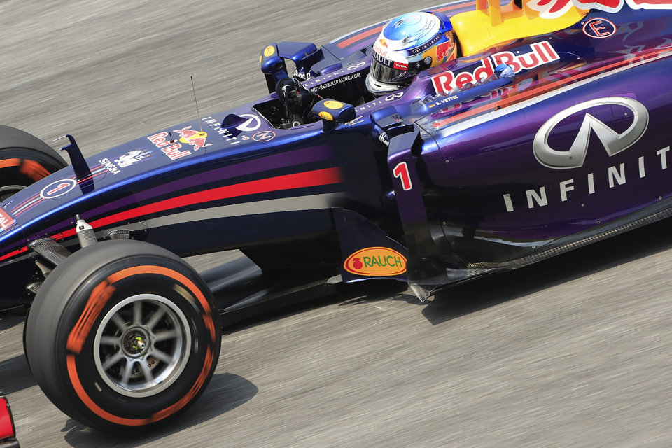Photo - Red Bull driver Sebastian Vettel of Germany steers his car during the second practice session for the Malaysian Formula One Grand Prix at Sepang International Circuit in Sepang, Malaysia, Friday, March 28, 2014. (AP Photo/Peter Lim)