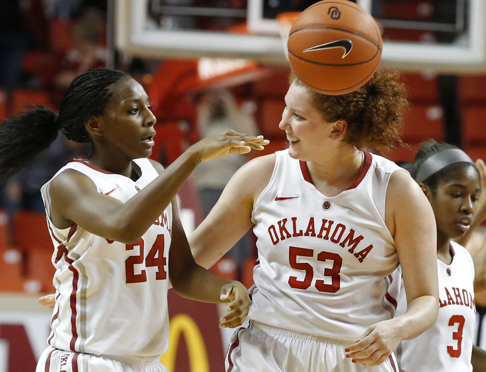 Photo - Oklahoma Sooner's Joanna McFarland (53) congratulates Sharane Campbell (24) after a rebound and is fouled with seconds remaining during the second half as the University of Oklahoma Sooners (OU) defeat the West Virginia Mountaineers 71-68 in NCAA, women's college basketball at The Lloyd Noble Center on Wednesday, Jan. 2, 2013  in Norman, Okla. Photo by Steve Sisney, The Oklahoman