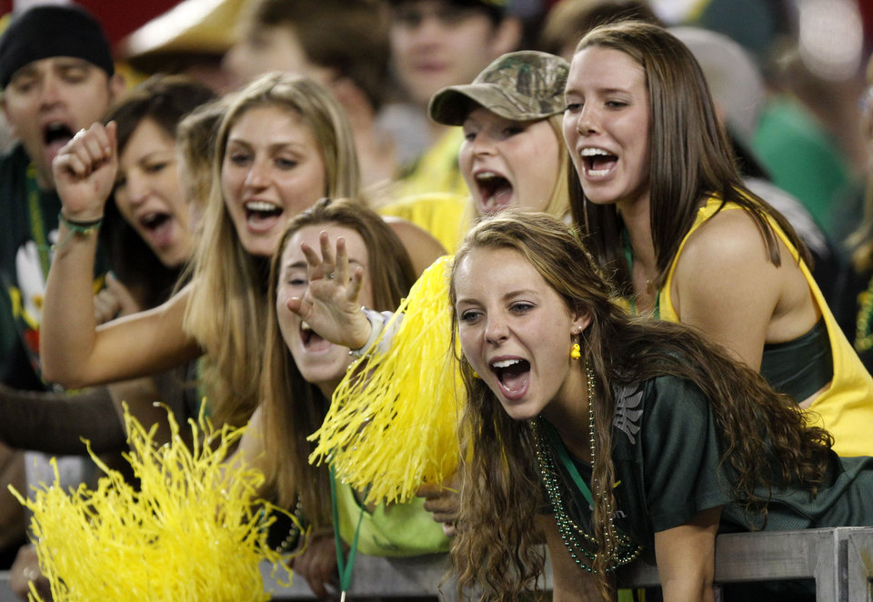 Oregon fans cheer during the second half of the Fiesta Bowl NCAA college football game, Thursday, Jan. 3, 2013, in Glendale, Ariz. Oregon defeated Kansas State 35-17.(AP Photo/Paul Connors)