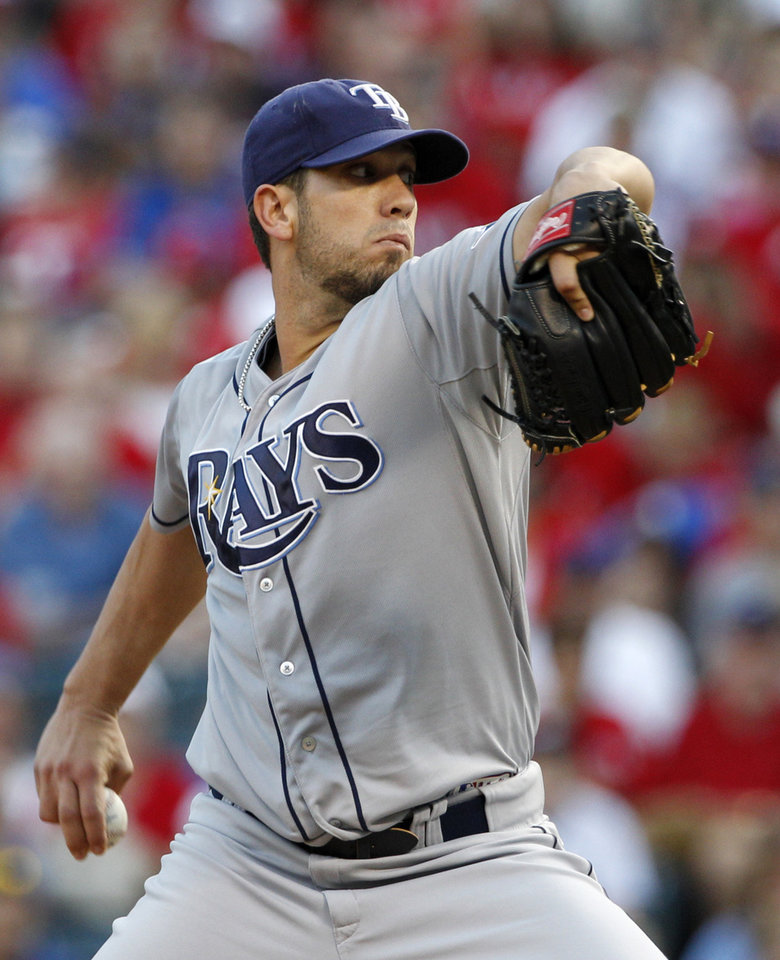 Photo -   Tampa Bay Rays starting pitcher James Shields winds up to deliver to the Texas Rangers in the first inning of a baseball game on Friday, April 27, 2012, in Arlington, Texas. (AP Photo/Tony Gutierrez)