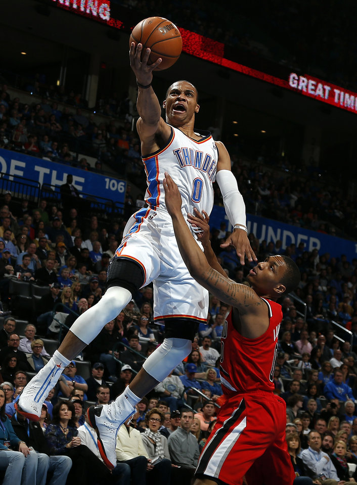 Oklahoma City\'s Russell Westbrook (0) shoots a lay up as Portland\'s Damian Lillard (0) defends during the NBA basketball game between the Oklahoma City Thunder and the Portland Trail Blazers at the Chesapeake Energy Arena in Oklahoma City, Sunday, March, 24, 2013. Photo by Sarah Phipps, The Oklahoman