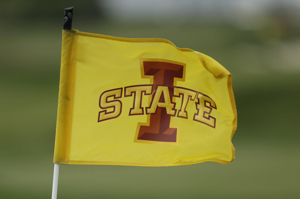 Photo - An Iowa State pin flag flaps in the wind on a practice green at the school's Golf Performance Center, Monday, May 19, 2014, in Ames, Iowa. Iowa State is headed to the NCAA tournament for the first time in 61 years, snapping one of the longest droughts. (AP Photo/Charlie Neibergall)