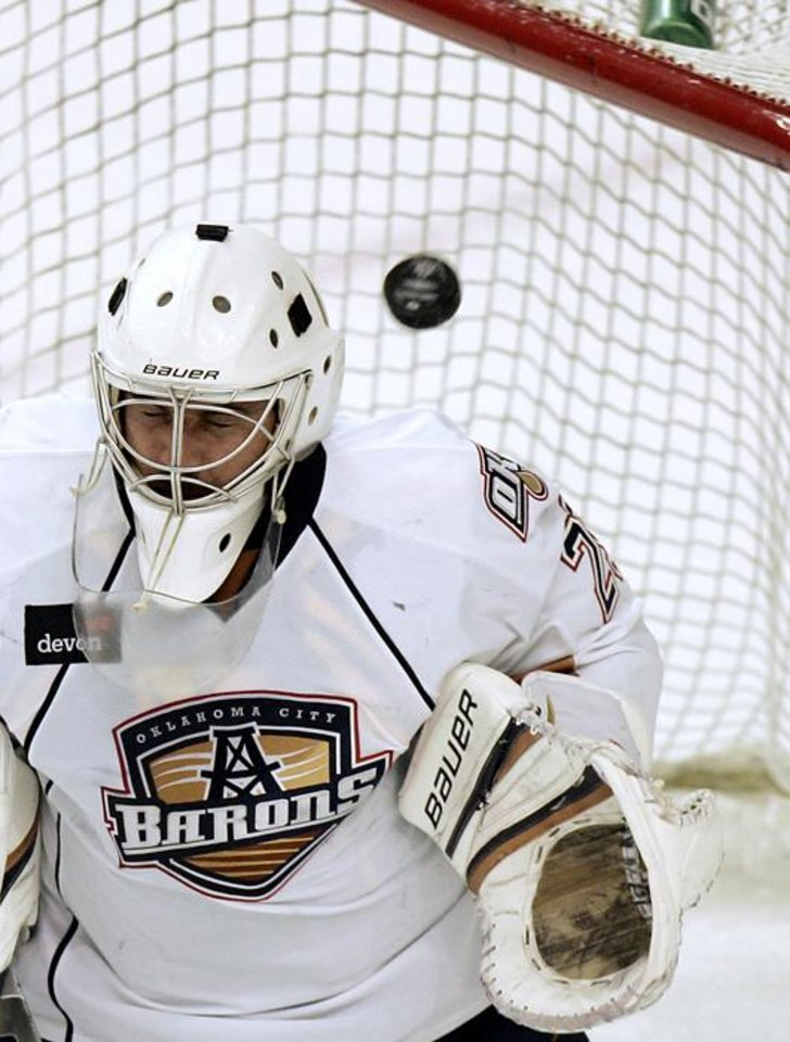 Photo -  A puck gets past Oklahoma City's goalie Martin Gerber during the Barons' game against Rockford during their game at the Cox Convention Center in Oklahoma City on Sunday, Dec. 2, 2011. Photo by John Clanton, The Oklahoman ORG XMIT: KOD