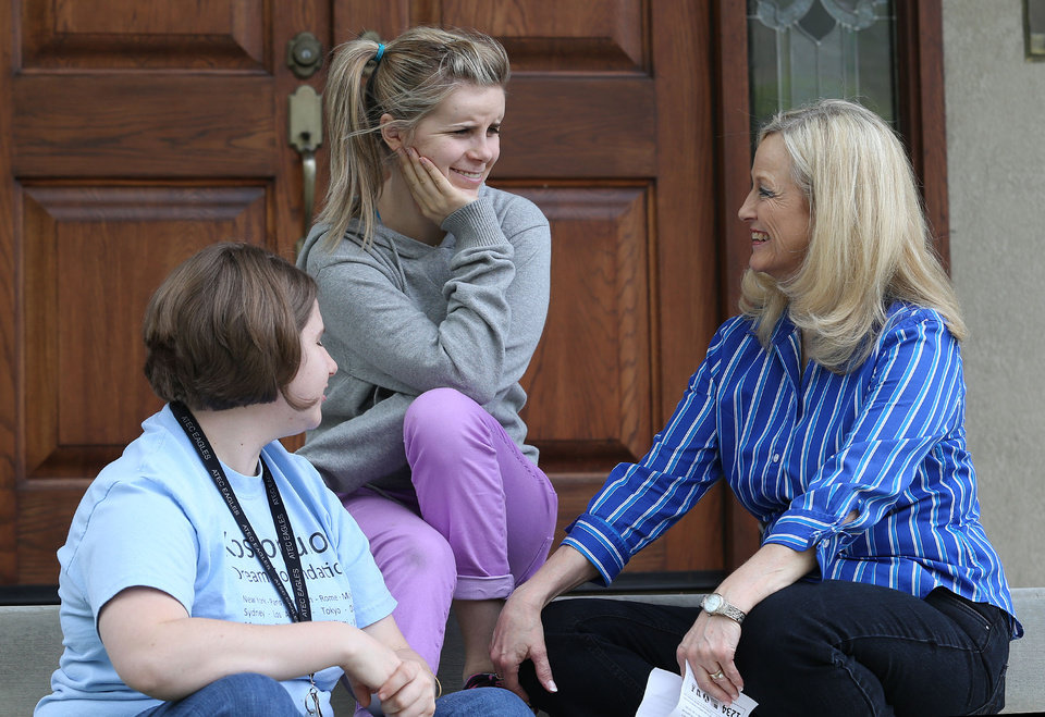 Photo -       Pheobe Blackham, talks with two of her daughters Tonya, left, and Shannon Monday, May 5, 2014, in Alpine.