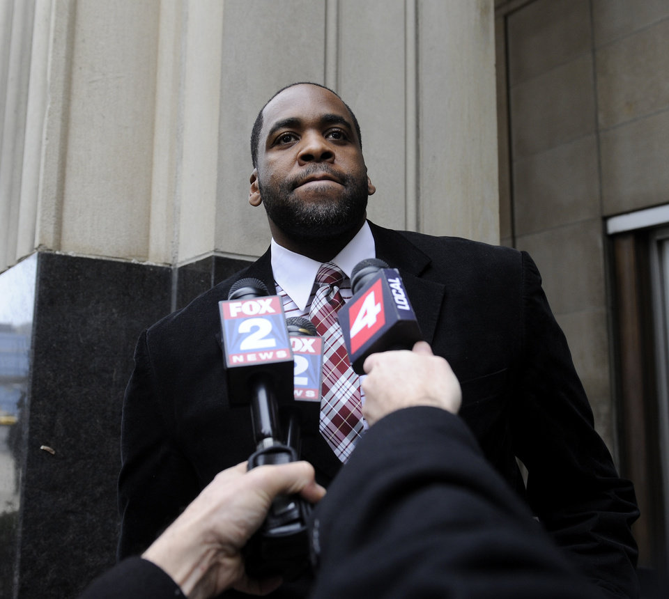 Photo - Former Detroit Mayor Kwame Kilpatrick leaves federal court after being convicted Monday, March 11, 2013, in Detroit, of corruption charges, ensuring a return to prison for a man once among the nation's youngest big-city leaders. (AP Photo/Detroit News, David Coates)