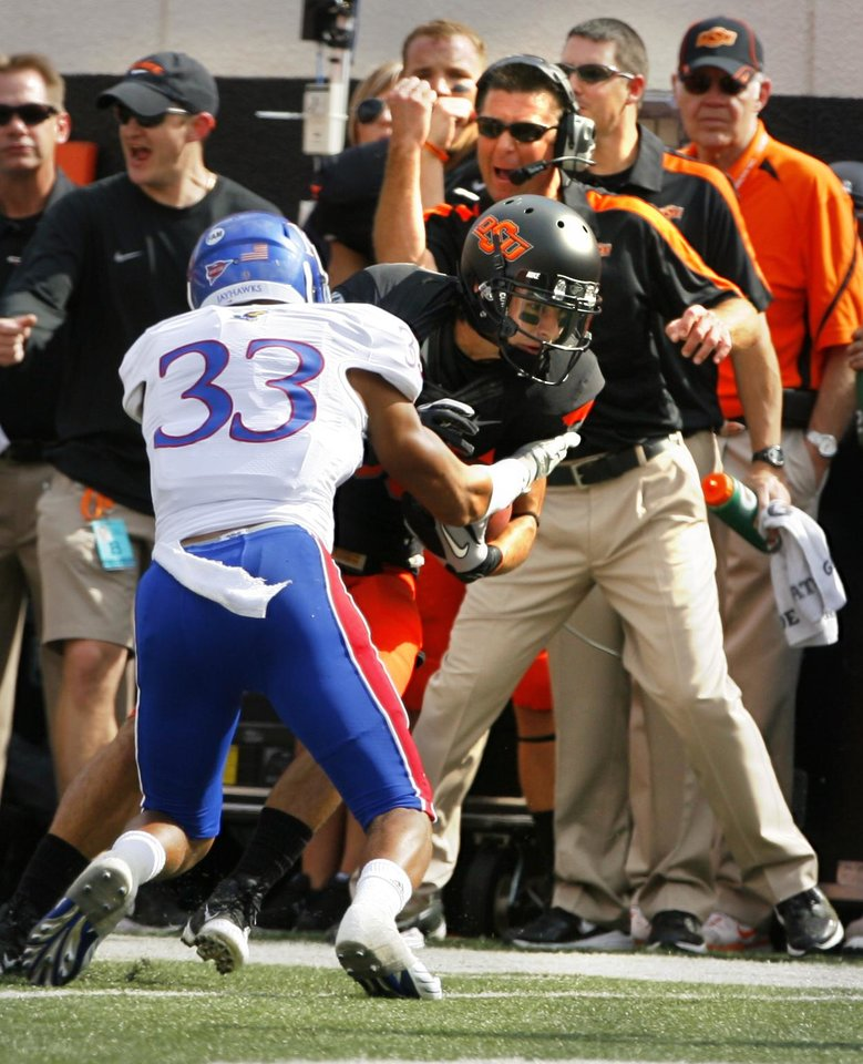 Oklahoma State head coach Mike Gundy reacts to a reception by Colton Chelf (83) during a college football game between the Oklahoma State University Cowboys (OSU) and the University of Kansas Jayhawks (KU) at Boone Pickens Stadium in Stillwater, Okla., Saturday, Oct. 8, 2011 Photo by Steve Sisney, The Oklahoman