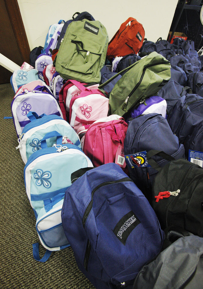 Finished backpacks filled by volunteers with school supplies at Sunbeam Family Services in Oklahoma City Monday, July 23, 2012.  Photo by Paul B. Southerland, The Oklahoman