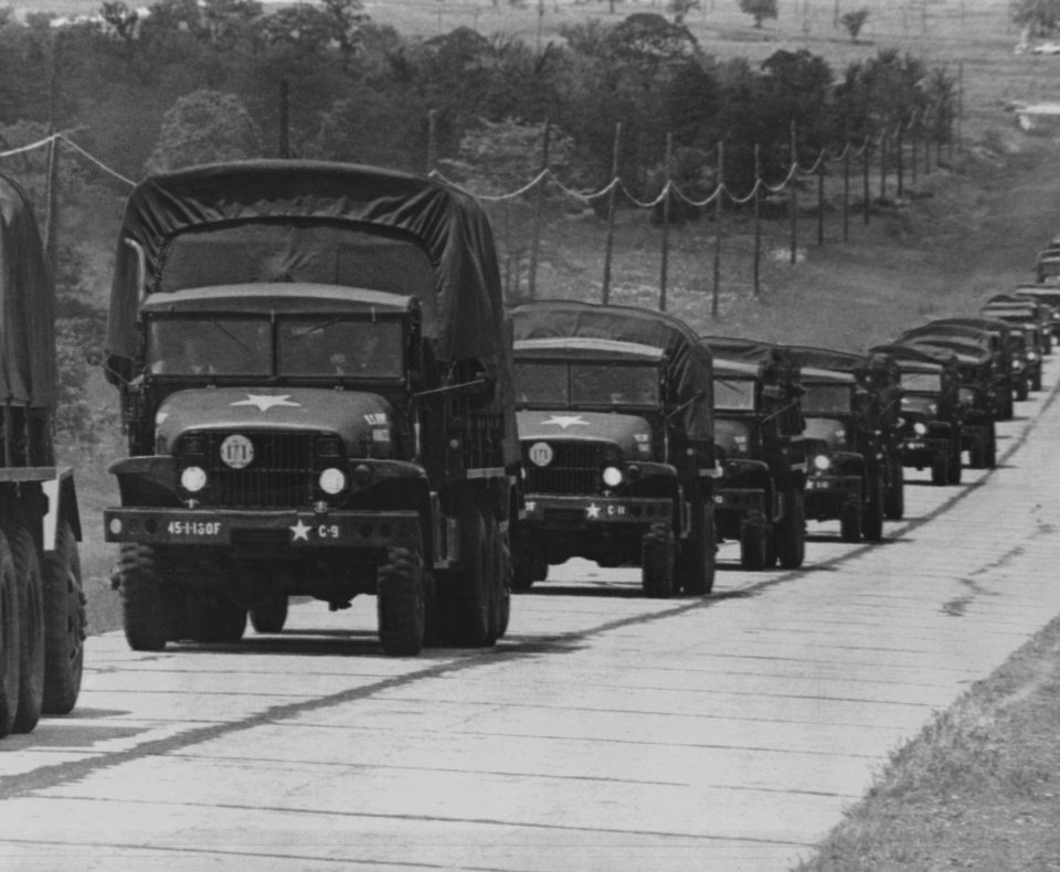 Photo - Thunderbird Convoy rolls into Fort Chaffee, Ark., Saturday afternoon, ending the final lap of a long journey which began before daylight.  The jeeps and trucks of this El Reno unit were part of the 1,900 vehicles of Oklahoma's 45th Infantry Division which made a motor march to the camp to begin two weeks of intensive combat training.  Story on page 22.  Staff photo by George Tapscott.  Original dated 05/27/1967.  Published in The Daily Oklahoman 05/28/1967.