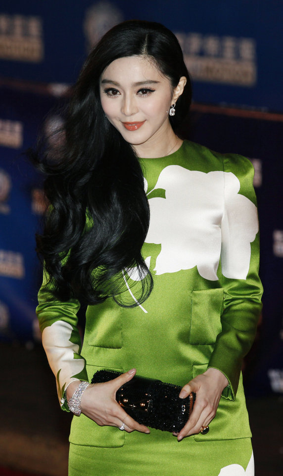 Photo - FILE- In this Wednesday, April 10, 2013 file photo, Chinese actress Fan Bing Bing poses on the red carpet at the Huading Awards in Hong Kong. Fan won best actress for