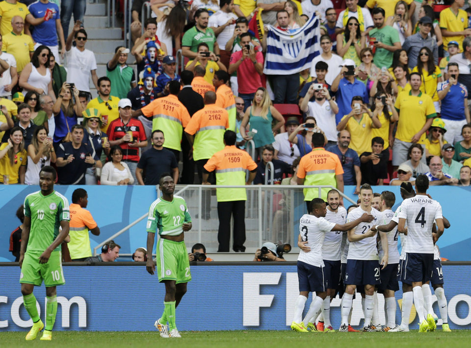 Photo - French players celebrate after Nigeria's Joseph Yobo scored an own goal giving France a 2-0 victory over during the World Cup round of 16 soccer match between France and Nigeria at the Estadio Nacional in Brasilia, Brazil, Monday, June 30, 2014. (AP Photo/Petr David Josek)