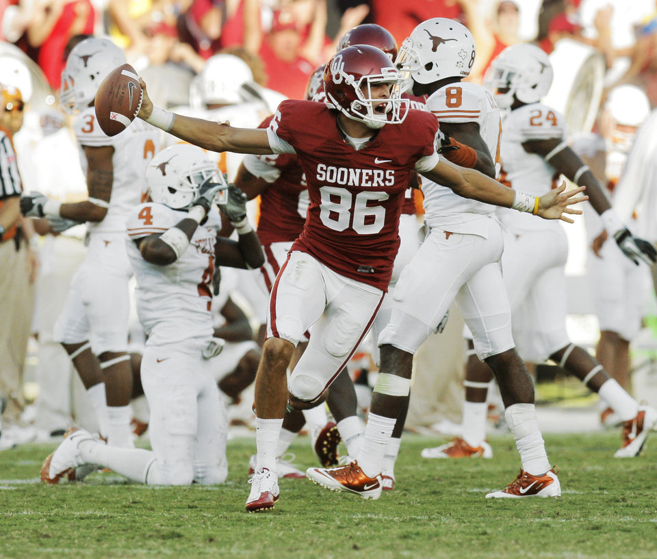 Photo - OU's James Winchester (86) celebrates after recovering a fumbled punt return by Aaron Williams (4) of Texas late in the fourth quarter by during the Red River Rivalry college football game between the University of Oklahoma Sooners (OU) and the University of Texas Longhorns (UT) at the Cotton Bowl on Saturday, Oct. 2, 2010, in Dallas, Texas. OU won, 28-20. Photo by Nate Billings, The Oklahoman