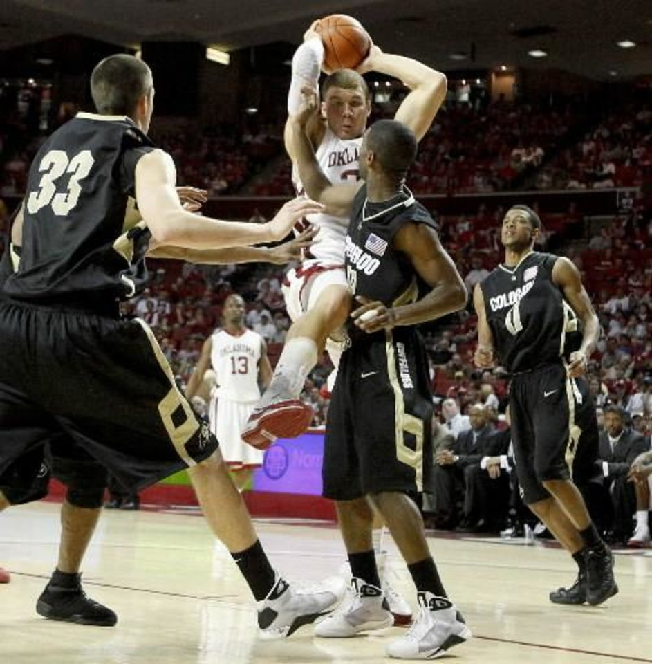 OU\'s Blake Griffin grabs a rebound between Colorado\'s Austin Dufault, left, Dwight Thorne III, and Cory Higgins during the Big 12 basketball game between Oklahoma and Colorado at Lloyd Noble Arena in Norman, Okla., Saturday, Feb. 7, 2009. PHOTO BY BRYAN TERRY