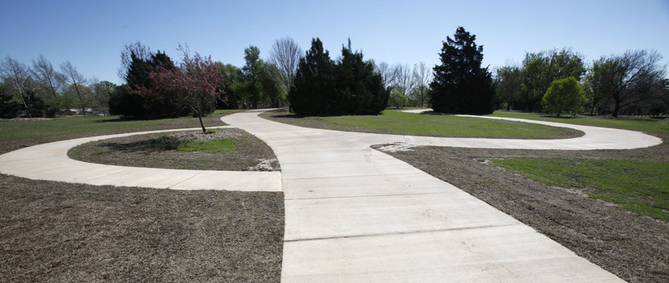 Photo - New American with Disabilities Act-compliant walkways at the arboretum at Will Rogers Gardens make the park more accessible. Oklahoma City celebrates Arbor Week next week.  PAUL HELLSTERN - The Oklahoman