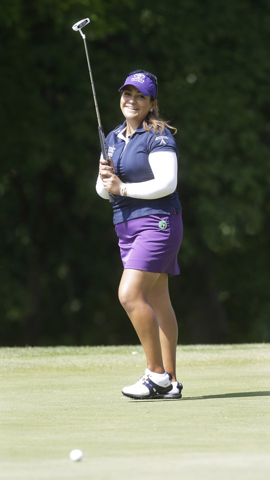 Photo - Lizette Salas reacts to a missed birdie putt on the fourth green during the final round of the Kingsmill Championship golf tournament at the Kingsmill resort  in Williamsburg, Va., Sunday, May 18, 2014.   (AP Photo/Steve Helber)