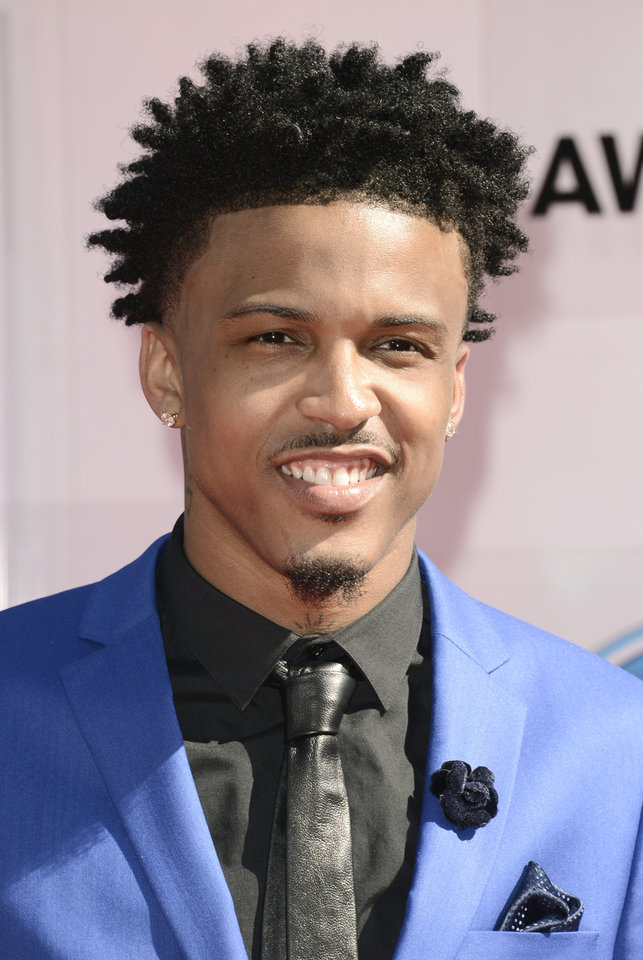 Photo - August Alsina arrives at the BET Awards at the Nokia Theatre on Sunday, June 29, 2014, in Los Angeles. (Photo by Dan Steinberg/Invision/AP)