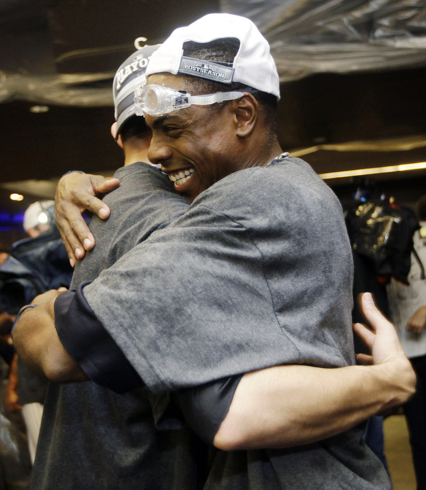 Photo -   New York Yankees' Curtis Granderson embraces a teammate as they celebrate their 14-2 win over the Boston Red Sox in their baseball game at Yankee Stadium in New York, Wednesday, Oct. 3, 2012. The Yankees clinched the American League East title. (AP Photo/Kathy Willens)