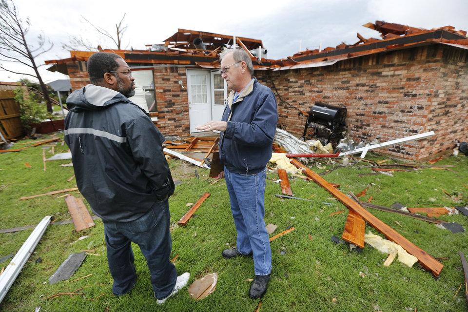 Photo - Saad Mohammed talks with Tony Chrisman with Home Creations at Saad's home on S Robinson in Oklahoma City, Thursday May 23, 2013. Saad's home was destroyed by the massive tornado that hit Monday. Photo By Steve Gooch, The Oklahoman  Steve Gooch