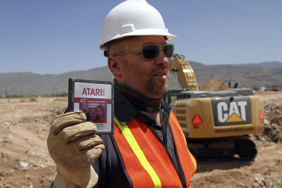 Photo - Film Director Zak Penn shows a box of a decades-old Atari 'E.T. the Extra-Terrestrial' game found in a dumpsite in Alamogordo, N.M., Saturday, April 26, 2014. Producers of a documentary dug in a southeastern New Mexico landfill in search of millions of cartridges of the game that has been called the worst game in the history of video gaming and were buried there in 1983. (AP Photo/Juan Carlos Llorca)