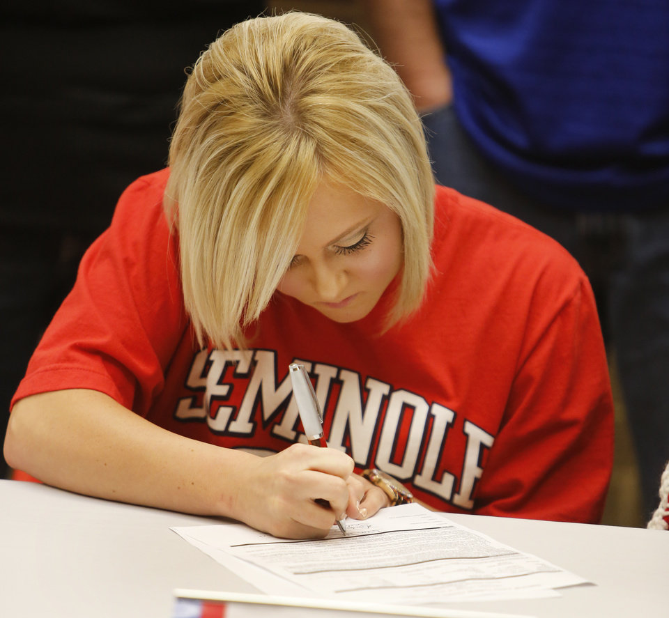 Photo - Westmoore's Erin Sanders signs to play softball for Seminole State University during a signing ceremony at Westmoore High School in Moore, Wednesday February  06, 2013. Photo By Steve Gooch, The Oklahoman