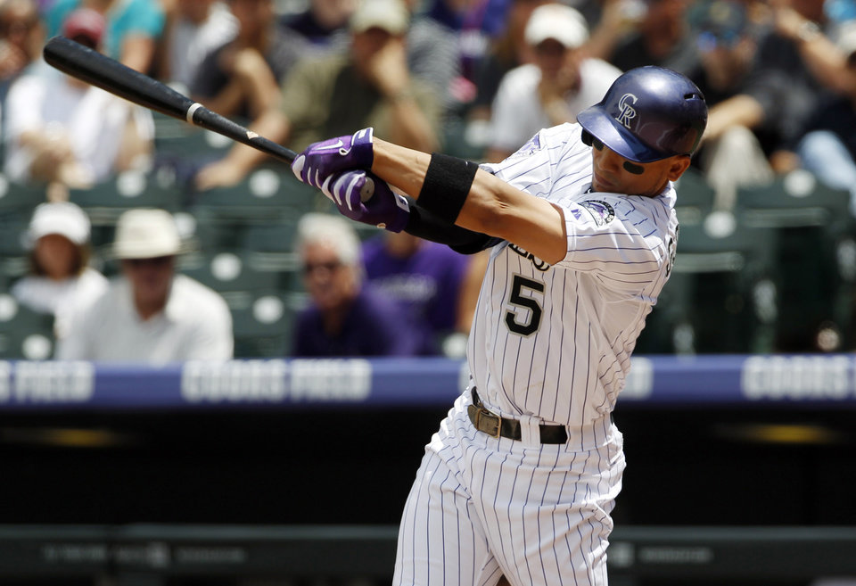 Photo - Colorado Rockies' Carlos Gonzalez strikes out against the Miami Marlins to end the first inning of a baseball game in Denver on Thursday, July 25, 2013. (AP Photo/David Zalubowski)