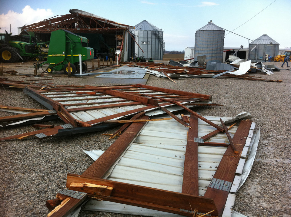 A barn damaged by what was to believed to be a tornado near Wadesville, Ind., is seen March 2, 2012. Powerful storms stretching from the U.S. Gulf Coast to the Great Lakes in the north wrecked two small towns, killed at least three people and bred anxiety across a wide swath of the country on Friday, in the second deadly tornado outbreak this week. (AP Photo/The Evansville Courier & Press, Denny Simmons)  ORG XMIT: INEVA101