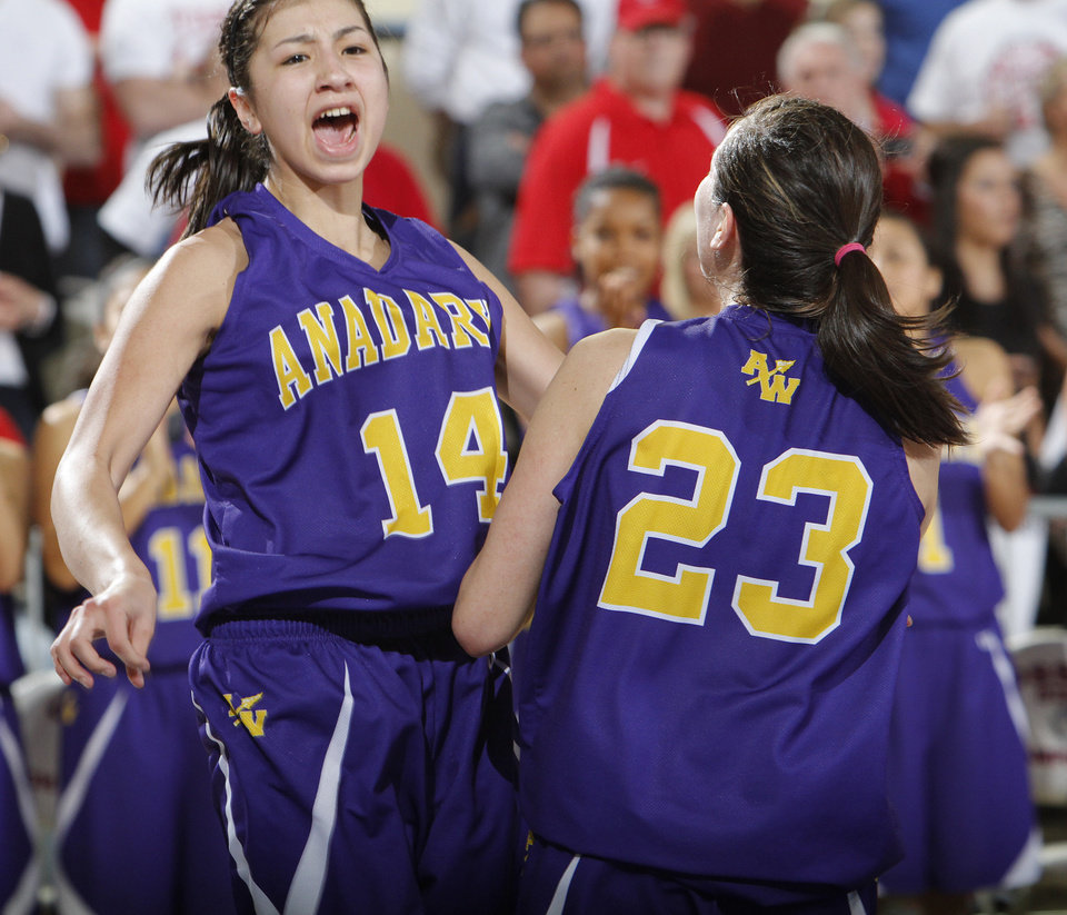 Photo - Anadarko's Ashley Beatty (14) and Lakota Beatty (23) celebrate the win over Ft. Gibson during the 4A girls State Basketball Championship game between Ft. Gibson High School and Anadarko High School at State Fair Arena on Saturday, March 10, 2012 in Oklahoma City, Okla.  Photo by Chris Landsberger, The Oklahoman