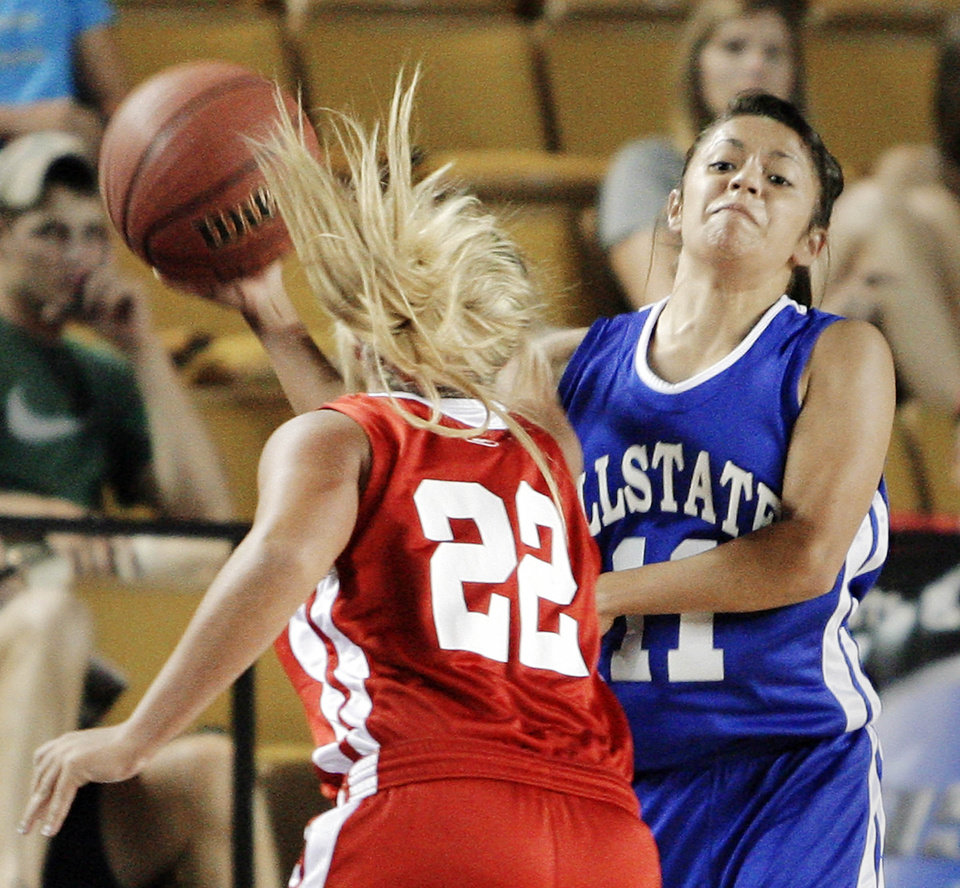 Photo - The West's Lexie Brown pressures the East's Courtney Backward on a pass during the All State Small School Girls Basketball game at Oral Roberts University in Tulsa, OK, July 25, 2012. MICHAEL WYKE/Tulsa World