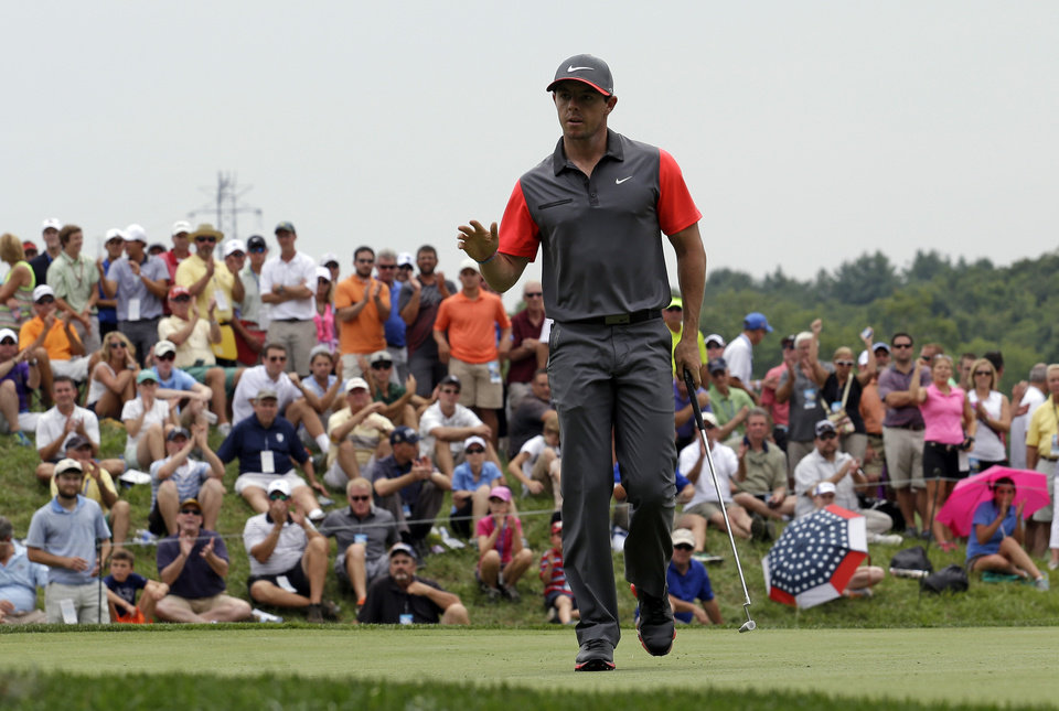 Photo - Rory McIlroy, of Northern Ireland, waves after a birdie on the fourth hole during the first round of the PGA Championship golf tournament at Valhalla Golf Club on Thursday, Aug. 7, 2014, in Louisville, Ky. (AP Photo/David J. Phillip)