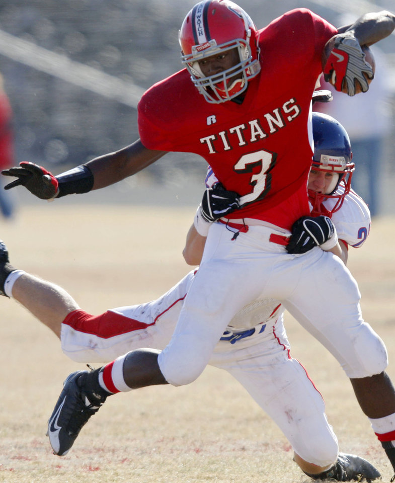 Photo - PLAYOFFS: Carl Albert's Travante Porter tries to get past  Bixby's  Matt Youngwirth during their high school football game at Carl Albert in Midwest City, Okla., on Saturday, Nov. 22, 2008. Carl Albert beat the Spartans 44-6. By John Clanton, The Oklahoman  ORG XMIT: KOD