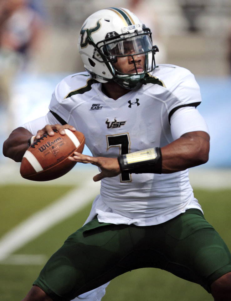 Photo -   South Florida quarterback B.J. Daniels throws against Nevada during the first half of an NCAA college football game, Saturday, Sept. 8, 2012, in Reno, Nev. (AP Photo/Cathleen Allison)
