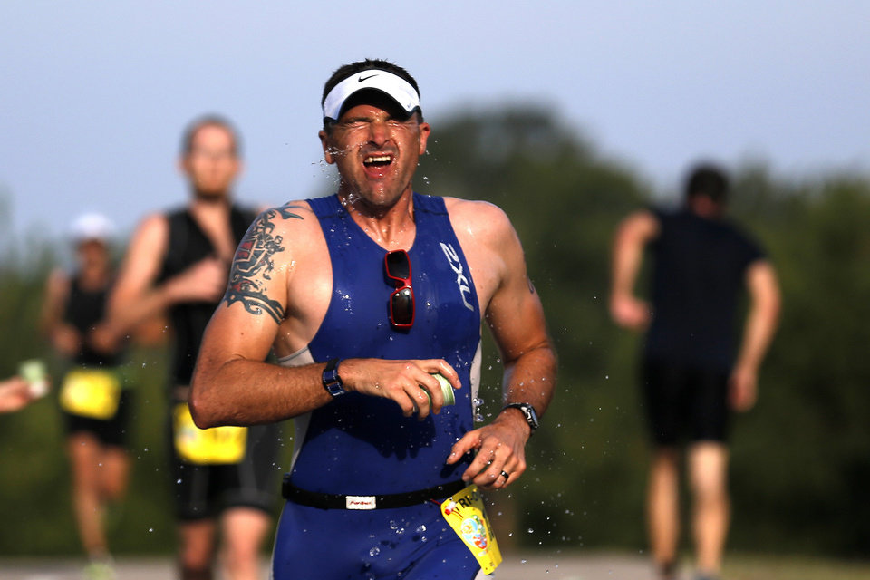 Craig Williamson of Yukon, Okla., reacts after pouring water on his face during the Arcadia Lake Triathlon and Aquabike in at Edmond Park in Arcadia Lake, Sunday, Aug 11, 2013. The race was 500 yd swim, 12.4 Mile/20k bike and a 3.1 mile/5k run. Photo by Sarah Phipps, The Oklahoman