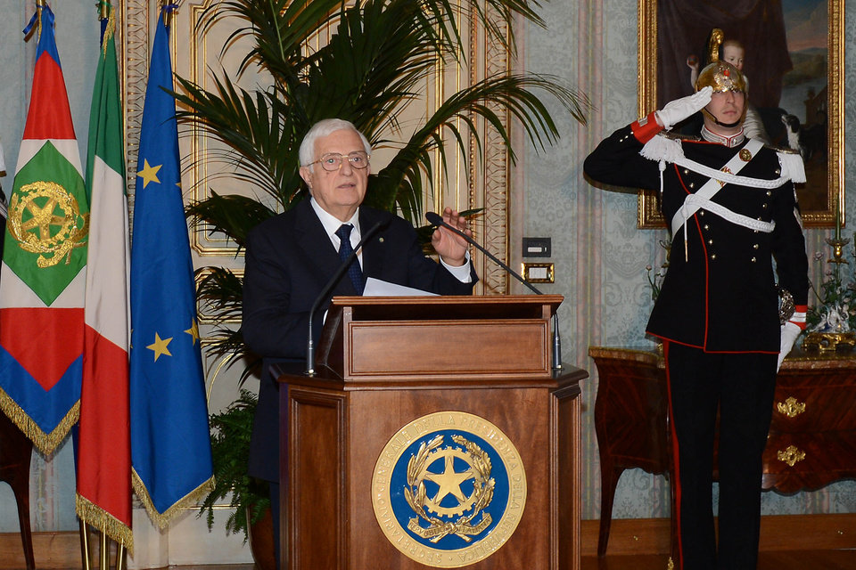 In this photo released by the Italian Presidency, the general secretary Donato Marra officially announces the resignation of Mario Monti at the Quirinale presidential palace in Rome Friday, Dec. 21, 2012. Mario Monti handed in his resignation to Italy\'s president in Rome on Friday, bringing to a close his 13-month technical government and preparing the country for national elections. President Giorgio Napolitano -- who tapped Monti in November 2011 to come up with reforms to shield Italy from the continent\'s debt crisis -- asked Monti to stay on as head of a caretaker government until the national vote, expected in February. (AP Photo/Antonio Di Gennaro, Italian Presidency ho)