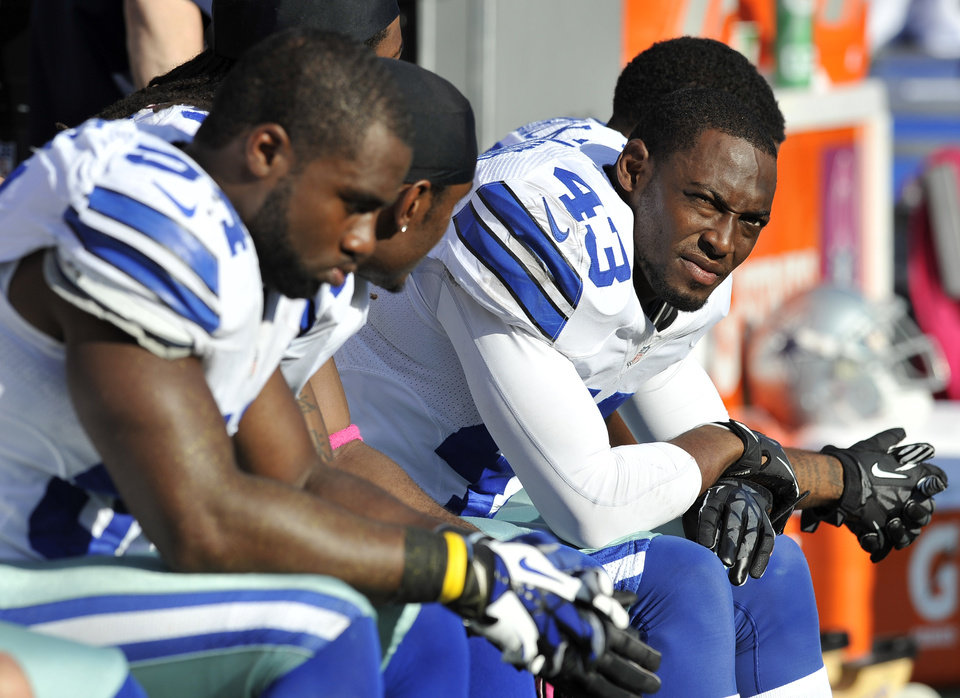 Photo -   Dallas Cowboys safety Gerald Sensabaugh (43) looks on from the sideline in the second half of an NFL football game against the Baltimore Ravens in Baltimore, Sunday, Oct. 14, 2012. Baltimore won 31-29. (AP Photo/Gail Burton)