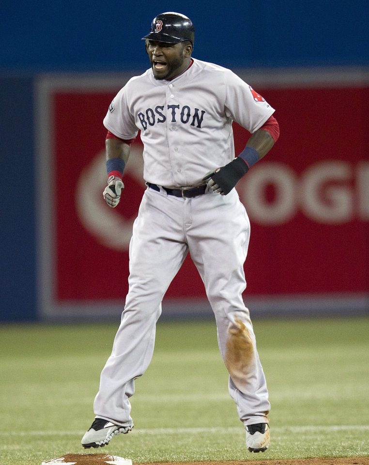 Photo -   Boston Red Sox's David Ortiz reacts after getting caught trying to steal second base during the seventh inning of a baseball game against the Toronto Blue Jays in Toronto on Monday, April 9, 2012. (AP Photo/The Canadian Press, Frank Gunn)