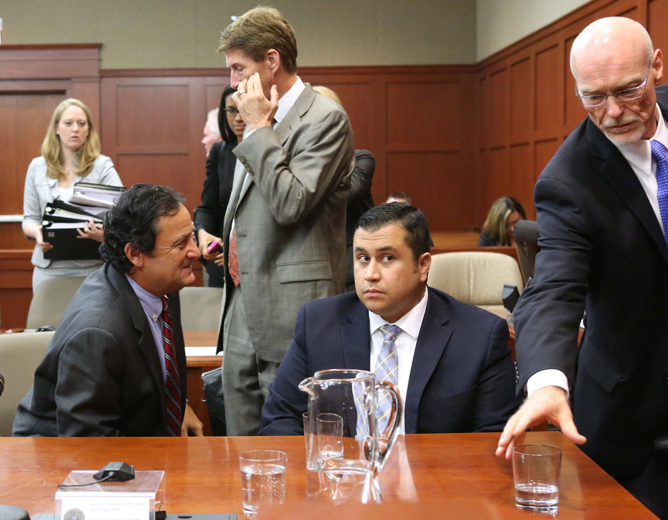 Photo - Defense attorney Mark O'Mara, second from left, jury consultant Robert Hirschhorn, left, George Zimmerman and co-counsel Don West, right, chat during a recess in Seminole circuit court during Zimmerman's trial, in Sanford, Fla., Tuesday, June 11, 2013. Zimmerman has been charged with second-degree murder for the 2012 shooting death of Trayvon Martin.(AP Photo/Orlando Sentinel, Joe Burbank, Pool)
