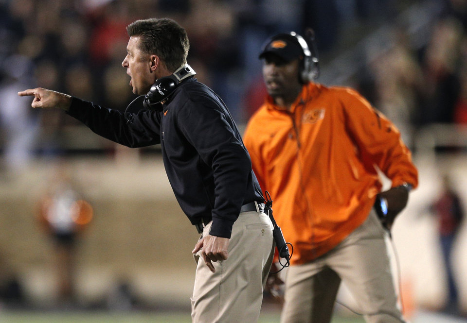 Photo - Oklahoma State head coach Mike Gundy argues a call during the college football game between the Oklahoma State Cowboys (OSU) and the Texas Tech Red Raiders (TTU) at Jones AT&T Stadium in Lubbock, Texas, Saturday, Nov. 2, 2013. Photo by Sarah Phipps, The Oklahoman