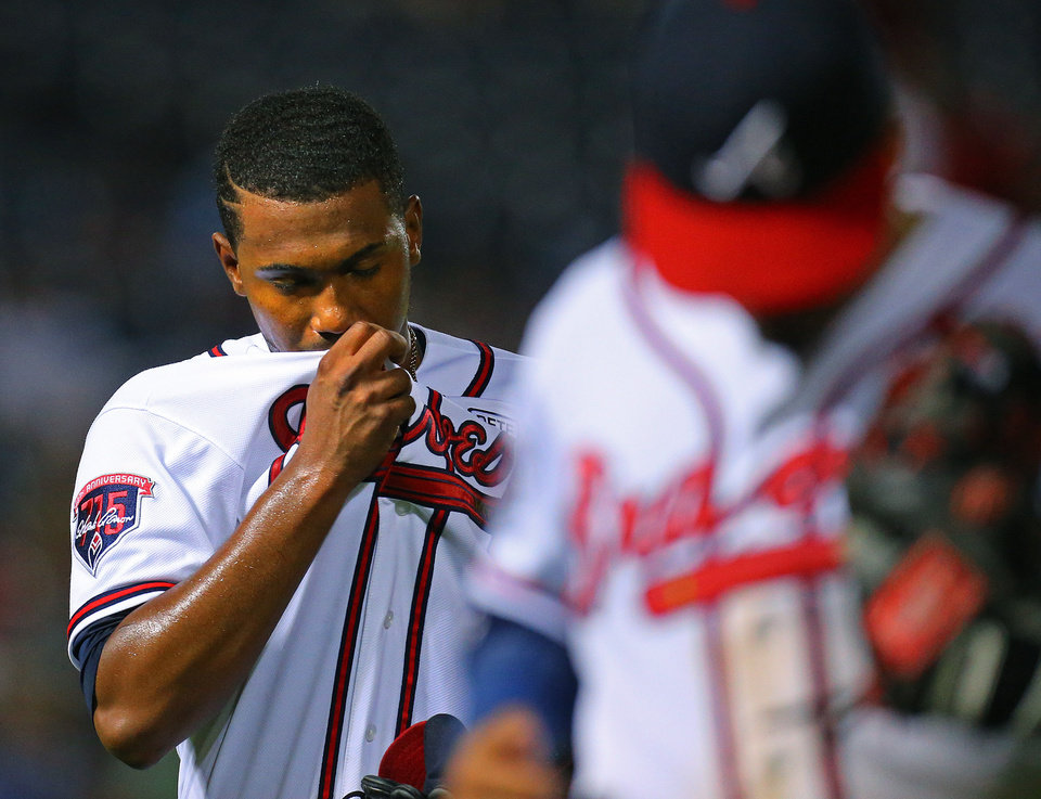 Photo - Atlanta Braves pitcher Julio Teheran reacts after giving up 3 runs to the Los Angeles Dodgers in the sixth inning to fall behind 3-1 in a baseball game on Monday, Aug. 11, 2014, in Atlanta.  (AP Photo/Atlanta Journal-Constitution, Curtis Compton)  MARIETTA DAILY OUT; GWINNETT DAILY POST OUT; LOCAL TELEVISION OUT; WXIA-TV OUT; WGCL-TV OUT