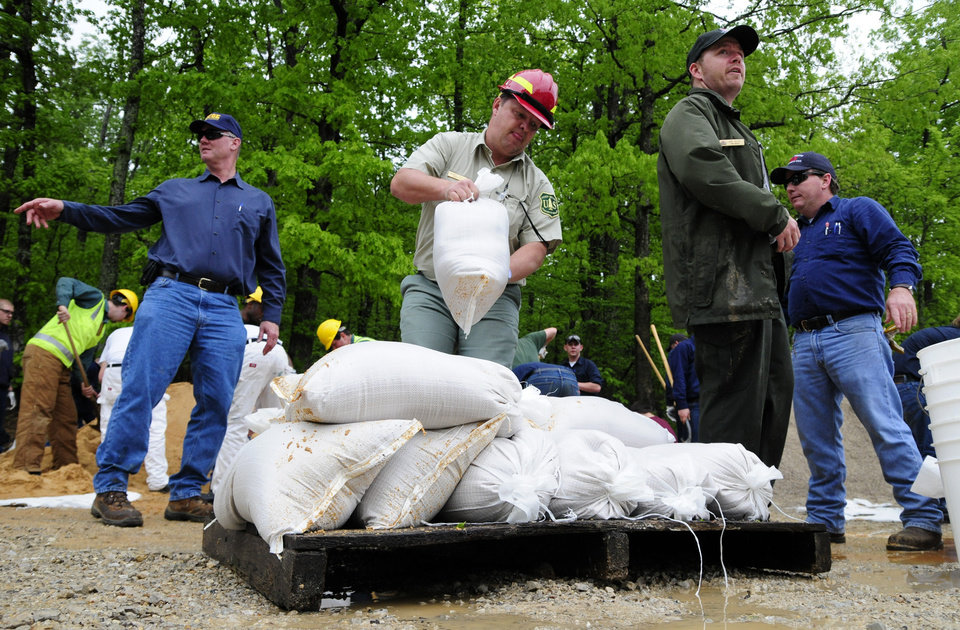 Photo - Officials with the U.S. Army Corps of Engineers and Mingo Job Corps work to fill sandbags Wednesday, April 27, 2011, which will be used in an attempt to stop water from overflowing the Wappapello Lake emergency spillway in Wayne County, Mo. (AP Photo/Daily American Republic, Paul Davis)