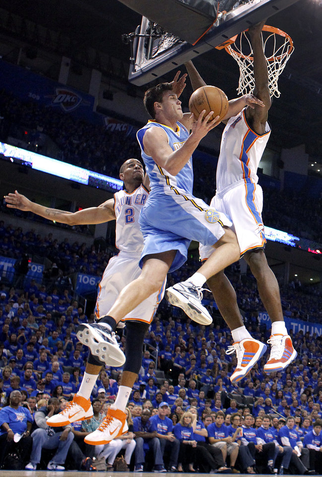 Photo - Denver's Danilo Gallinari (8) drives to the basket past Oklahoma City's Thabo Sefolosha (2) and Oklahoma City's Serge Ibaka (9) during the first round NBA playoff game between the Oklahoma City Thunder and the Denver Nuggets on Sunday, April 17, 2011, in Oklahoma City, Okla. Photo by Chris Landsberger, The Oklahoman