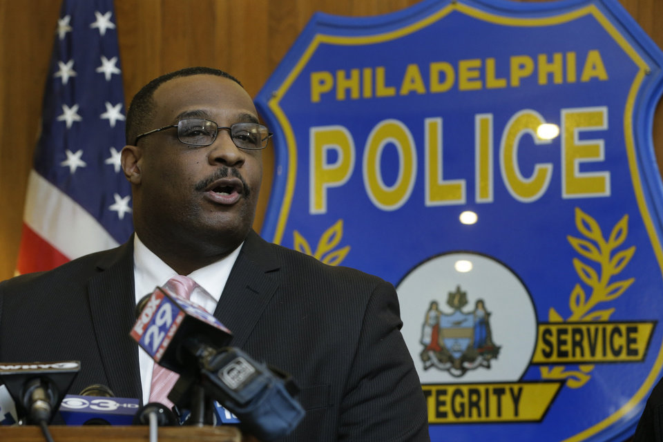 Photo - Homicide unit Capt. James Clark speaks during a news conference Thursday, Jan. 24, 2013, in Philadelphia. Clark says an exterminator, 36-year-old Jason Smith, has been charged with strangling a young Philadelphia doctor found bound and burned in her city row home. (AP Photo/Matt Rourke)