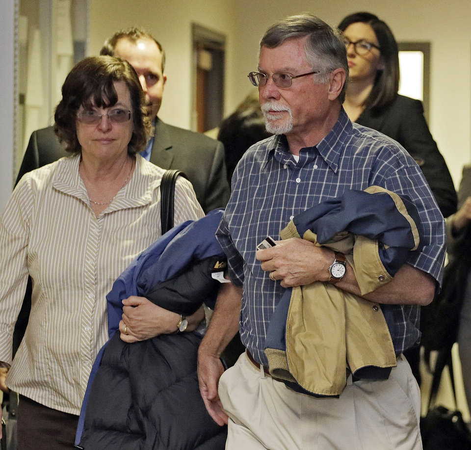 Robert and Arlene Holmes arrive at district court for a hearing in the case of their son, Aurora theater shooting suspect James Holmes, in Centennial, Colo., on Monday, April 1, 2013. The prosecutor announced he will seek the death penalty against Holmes. (AP Photo/Ed Andrieski)