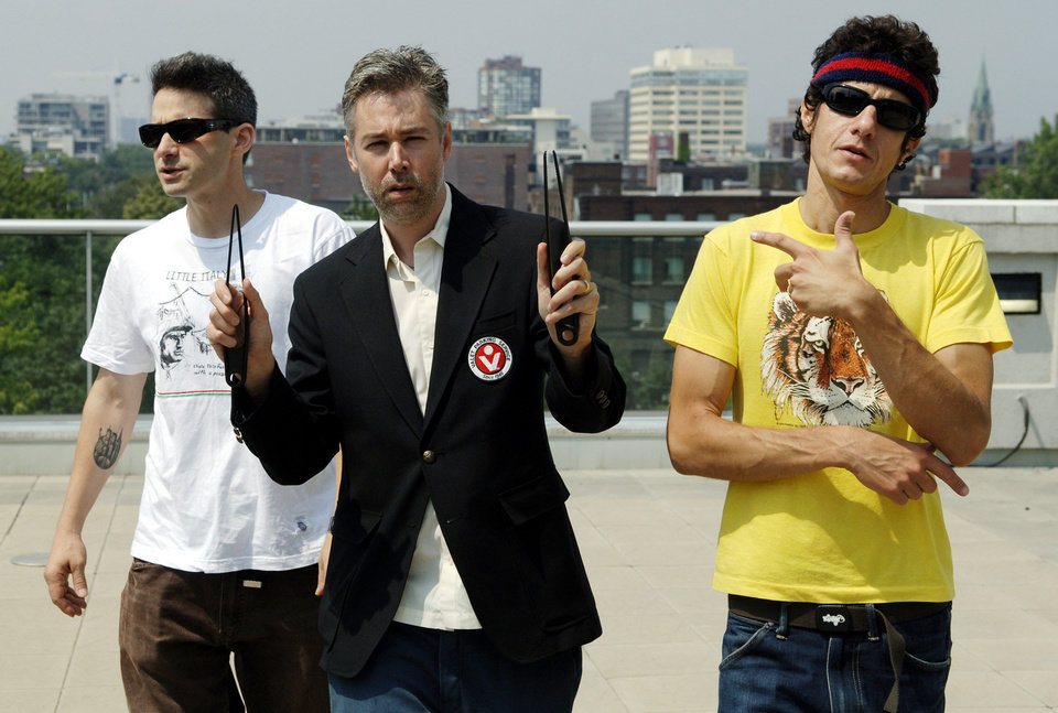 "FILE - In this July 26, 2006 file photo, Beastie Boys members Adam Yauch ""MCA,"" center, Adam Horovitz ""Adrock,"" left, and Mike Diamond ""Mike D,"" reflected in a mirror, pose for a photograph during an interview in Toronto, Wednesday, July 26, 2006. Yauch, the gravelly voiced Beastie Boys rapper who co-founded the seminal hip-hop group, has died at age 47. The cause of death wasn't immediately known. Yauch, who's also known as MCA, was diagnosed with a cancerous parotid gland in 2009. (AP Photo/The Canadian Press, Aaron Harris)"