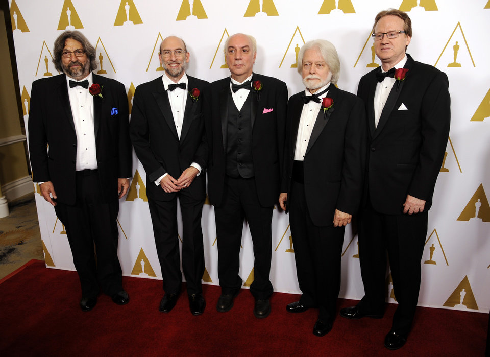 Photo - Left to right, Lou Levinson, David Reisner, Joshua Pines, Curtis Clark, ASC, and David Register, developers of the American Society of Cinematographers' Color Decision List technology and recipients of a Technical Achievement Award, pose together at the Academy of Motion Picture Arts and Sciences' annual Scientific and Technical Awards on Saturday, Feb. 15, 2014, in Beverly Hills, Calif. (Photo by Chris Pizzello/Invision/AP)