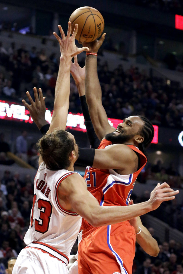Los Angeles Clippers center Ronny Turiaf (21) shoots over Chicago Bulls center Joakim Noah during the first half of an NBA basketball game, Tuesday, Dec. 11, 2012, in Chicago. (AP Photo/Charles Rex Arbogast)